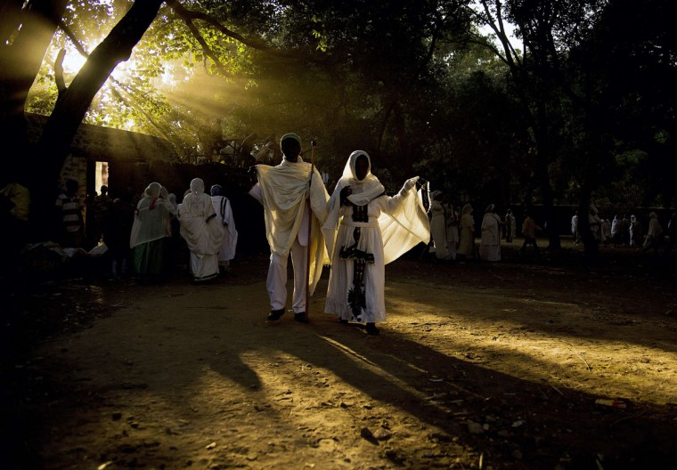 Ethiopian orthodox Christians walk toward the Fasilides baths during the Timkat festival in Gondar on January 20, 2014. (CARL DE SOUZA/AFP/Getty Images)