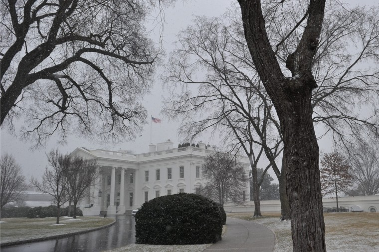 The White House is seen under snowfall on January 21, 2014 in Washington, DC. The US government shut itself down Tuesday as a major snowstorm bearing down on the northeastern United States threatened to dump as much as 10 inches (25 centimeters) on Washington by day's end. (Mandel Ngan/AFP/Getty Images)