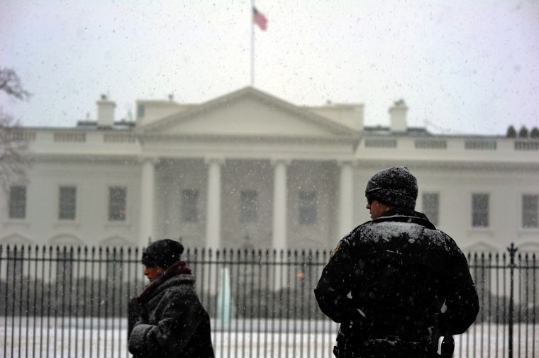 A member of the US Secret Service Uniform Division mans his post outside of the White House under a snowfall on January 21, 2014 in Washington, DC. The northeastern United States hunkered down Tuesday for a major snowstorm that forecasters warned could leave as much as one foot (30 centimeters) of snow in some places. Downtown Washington fell virtually silent after the federal government, seeing the swift-moving cold front approaching, closed its doors and told civil servants to stay home. Many offices and schools followed suit, as 20 mile (32 kilometer) per hour winds whipped the falling snow through the unusually quiet streets. Enough snow was expected to fall on the US capital to turn the evening rush hour into a Beltway traffic nightmare, as the storm churned its way into New York and the northeastern New England states (Jewel Samad/AFP/Getty Images)