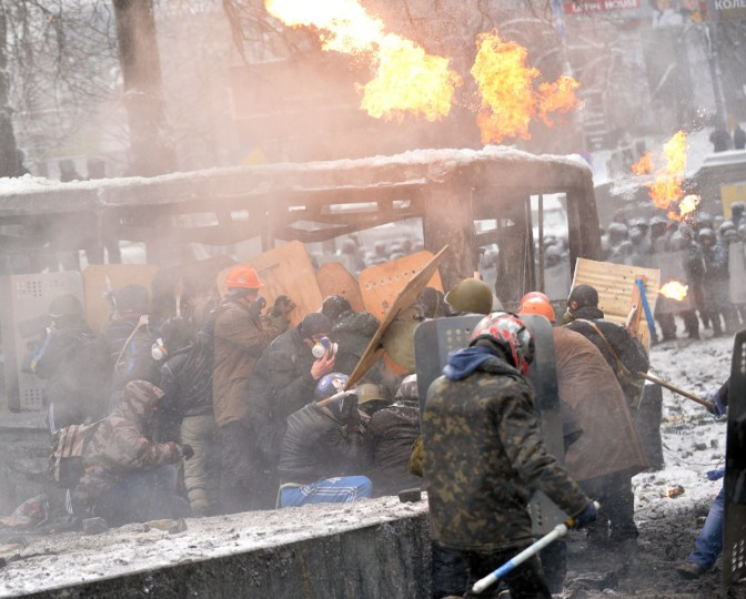 Protesters clash with the police in the center of Kiev on January 22, 2014. Ukrainian police on Wednesday stormed protesters' barricades in Kiev as violent clashes erupted and activists said that one person had been shot dead by the security forces. Total of two activists shot dead during clashing. The move by police increased tensions to a new peak after two months of protests over President Viktor Yanukovych's failure to sign a deal for closer ties with the EU. (Sergei Supinsky/AFP/Getty Images)