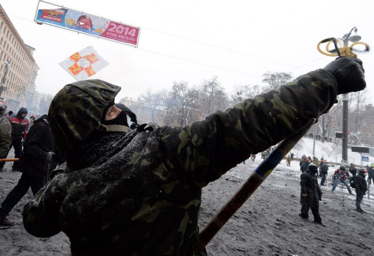 A protester uses a sling-shot during clashes with the police in the center of Kiev on January 22, 2014. Ukrainian police on Wednesday stormed protesters' barricades in Kiev as violent clashes erupted and activists said that one person had been shot dead by the security forces. Total of two activists shot dead during clashing. The move by police increased tensions to a new peak after two months of protests over President Viktor Yanukovych's failure to sign a deal for closer ties with the EU. (Vasily MakimovAFP/Getty Images)