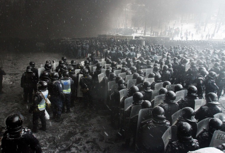 Riot police officers gather as they clash with protestors in the center of Kiev on January 22, 2014. Ukrainian police today stormed protesters' barricades in Kiev as violent clashes erupted and activists said that one person had been shot dead by the security forces. Total of two activists shot dead during clashing. The move by police increased tensions to a new peak after two months of protests over President Viktor Yanukovych's failure to sign a deal for closer ties with the EU. (Anatoli Boiko/AFP/Getty Images)