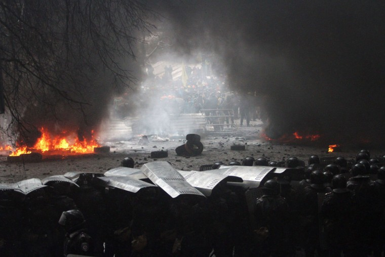 Riot police officers clash with protestors in the center of Kiev on January 22, 2014. Ukrainian police today stormed protesters' barricades in Kiev as violent clashes erupted and activists said that one person had been shot dead by the security forces. Total of two activists shot dead during clashing. The move by police increased tensions to a new peak after two months of protests over President Viktor Yanukovych's failure to sign a deal for closer ties with the EU. (Anatoli Boiko/AFP/Getty Images)