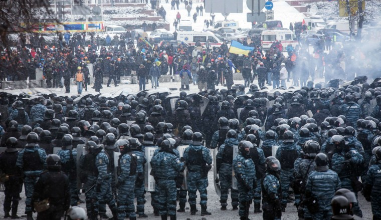 Protesters clash with police in the center of Kiev on January 22, 2014. Ukrainian police on Wednesday stormed protesters' barricades in Kiev amid violent clashes that left five activists dead, the first fatalities in two months of anti-government protests. Pitched battles raged in the centre of the Ukrainian capital as protesters hurled stones and Molotov cocktails at police and the security forces responded with tear gas, stun grenades and rubber bullets.(Oleksander Ratushini/AFP/Getty Images)