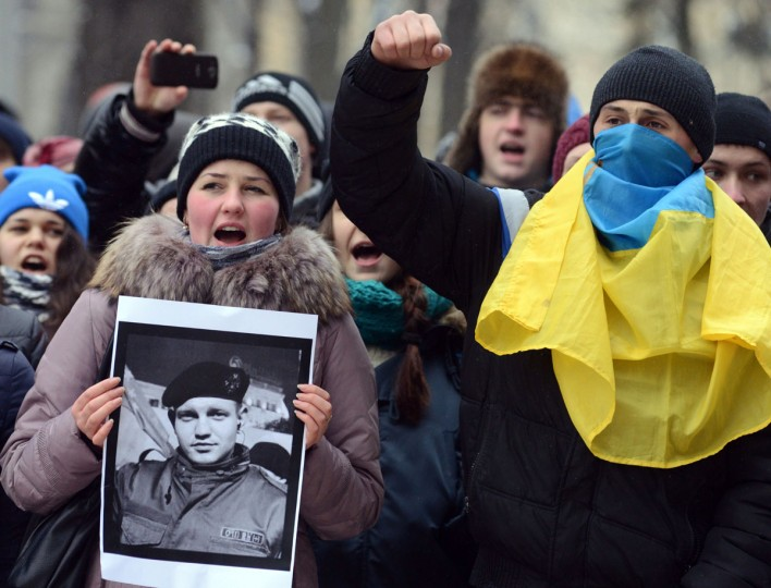 Ukrainians shout slogans during a ceremony in the western city of Lviv on January 23, 2014 in memory of protesters killed in clashes with riot police. Ukraine's opposition agreed to observe an eight-hour truce in clashes with security forces after five days of deadly fighting but threatened to go on the attack if the government failed to agree concessions. Opposition leader and world boxing champion Vitali Klitschko brokered the truce after talks with radical protesters and armoured security forces on the frontline of the clashes, saying the ceasefire should hold while he conducts talks with President Viktor Yanukovych. (Yuriy Dyachyshyn/AFP/Getty Images)