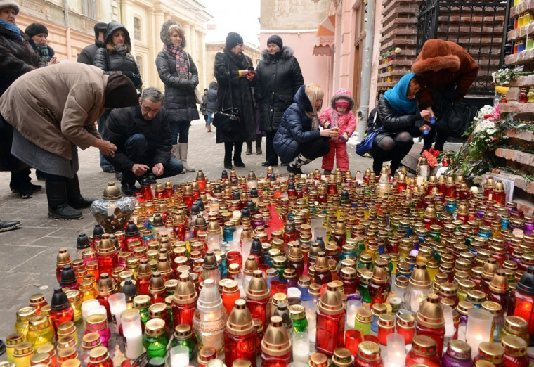 Ukrainians light candles during a ceremony in the western city of Lviv on January 23, 2014 in memory of protesters killed during clashes between the pro-EU opposition and riot police in Kiev. Ukraine's opposition agreed to observe an eight-hour truce in clashes with security forces after five days of deadly fighting but threatened to go on the attack if the government failed to agree concessions. Opposition leader and world boxing champion Vitali Klitschko brokered the truce after talks with radical protesters and armoured security forces on the frontline of the clashes, saying the ceasefire should hold while he conducts talks with President Viktor Yanukovych. (Yuriu Dyachyshyn/AFP/Getty Images)