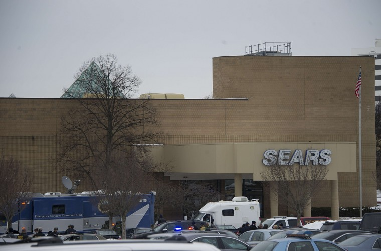 "Police patrol outside a Sears store at Columbia Mall after a fatal shooting on January 25, 2014, in Columbia, Maryland. Three people were killed in a shooting at the popular shopping mall, located about 45 minutes outside Washington, authorities said Saturday. Howard County, Maryland, Police announced the fatalities and urged people inside the Mall ""to stay in place.""Police said one of the dead was ""located near gun and ammunition."" (Jim Watson/AFP/Getty Images)"