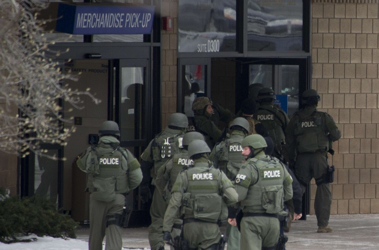 "Police enter the Sears department store at the Columbia Mall after a fatal shooting on January 25, 2014, in Columbia, Maryland. Three people were killed in a shooting at the popular shopping mall, located about 45 minutes outside Washington, authorities said Saturday. Howard County, Maryland, Police announced the fatalities and urged people inside the Mall ""to stay in place.""Police said one of the dead was ""located near gun and ammunition."" (Jim Watson/AFP/Getty Images)"