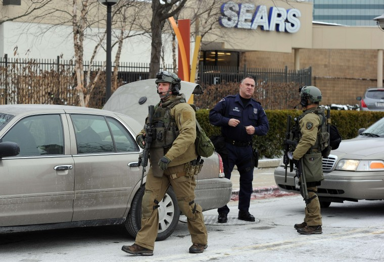 "Emergency responders arrive at the Columbia Mall after a fatal shooting on January 25, 2014, in Columbia, Maryland. Three people were killed in a shooting at the popular shopping mall, located about 45 minutes outside Washington, authorities said Saturday. Howard County, Maryland, Police announced the fatalities and urged people inside the Mall ""to stay in place.""Police said one of the dead was ""located near gun and ammunition."" (Jewel Samad/AFP/Getty Images)"