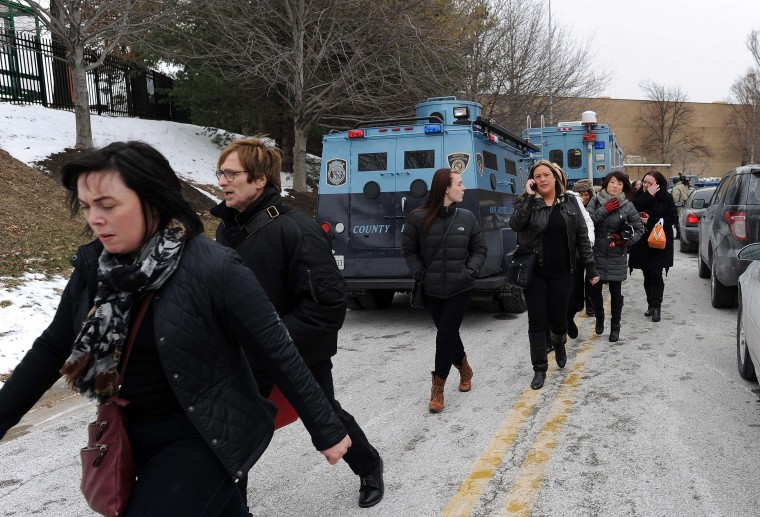 Shoppers are evacuted after a fatal shooting at Columbia Mall on January 25, 2014, in Columbia, Maryland. Three people were killed in a shooting at the popular shopping mall, located about 45 minutes outside Washington, authorities said Saturday. (Jewel Samad/AFP/Getty Images)