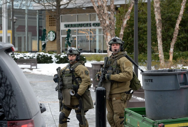 "Maryland State police officers patrol the Columbia Mall after a fatal shooting on January 25, 2014, in Columbia, Maryland. Three people were killed in a shooting at the popular shopping mall, located about 45 minutes outside Washington, authorities said Saturday. Howard County, Maryland, Police announced the fatalities and urged people inside the Mall ""to stay in place.""Police said one of the dead was ""located near gun and ammunition."" (Jewel Samad/AFP/Getty Images)"