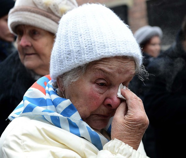 Former concentration camp prisoners attend a ceremony at the memorial site of the former Nazi concentration camp Auschwitz-Birkenau in Oswiecim, Poland, on Holocaust Day, on January 27, 2014. The ceremony took place 69 years after the liberation of the death camp by Soviet troops, in rememberance of the victims of the Holocaust. (Janek Skarzynski//AFP/Getty Images)