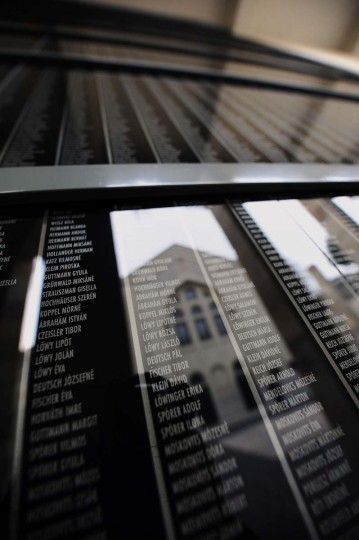 The local synagogue is reflected on the black marble wall with the names of the Hungarian holocaust victims at the memorial of Central Europe's first Holocaust museum in Budapest on January 27, 2014. The International Holocaust Memorial Day on January 27, 2014 marks the 70th anniversary of the liberation of Nazi concentration camp in Auschwitz-Birkenau. (Atilla Kisbenedek/AFP/Getty Images)