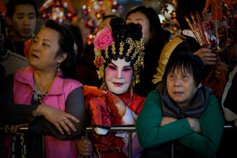 Worshippers wait to burn incense and pray at the Wong Tai Sin Temple to welcome the Chinese New Year of the horse in Hong Kong on January 30, 2014. Tens of thousands of worshippers flocked to temples across to pray for good luck and fortune for the new year. (Philippe Lopez/AFP/Getty Images)