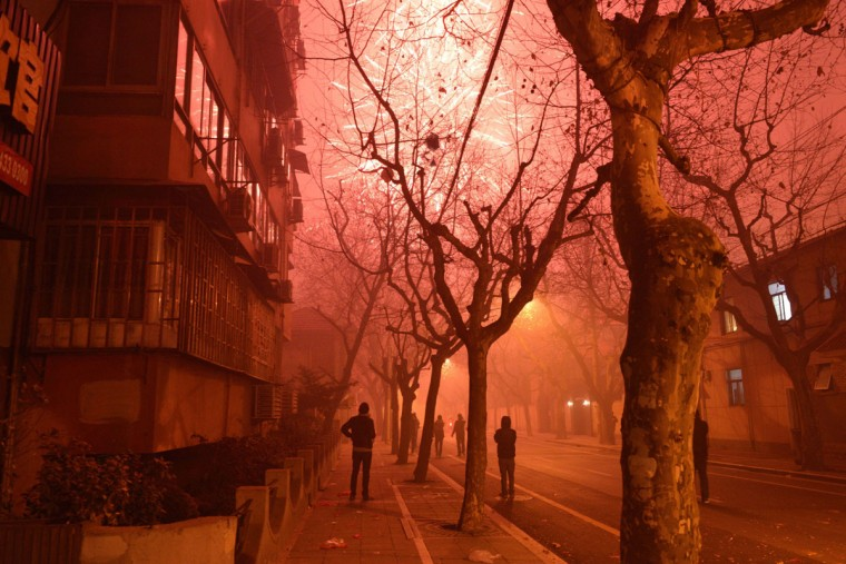 Fireworks explode in a street of Shanghai on the eve of Chinese New Year on January 30, 2014. China prepares to welcome the Lunar New Year of the Horse which falls on January 31 and will see about 3.62 billion trips made by Chinese travelers during the 40-day Spring Festival travel period. (Peter Parks/AFP/Getty Images)