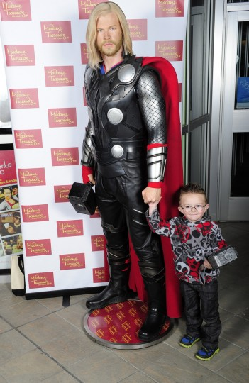 Guests pose with a wax figure of Thor at AMC Town Square on November 8, 2013 in Las Vegas, Nevada. (Steven Lawton/Getty Images)