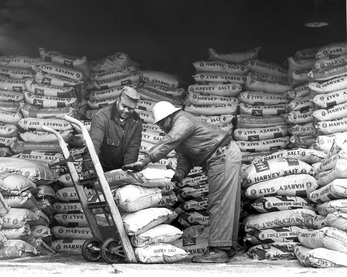 In 1961 workers stack bags of rock salt being unloaded at Druid Hill snow station. (Paul Hutchins/Baltimore Sun)