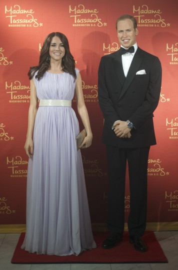 Catherine, Duchess of Cambridge, and Prince William, Duke of Cambridge during the unveiling of their wax figures at Madame Tussauds in Washington, DC, September 12, 2013. Madame Tussauds has a close relationship with the British Royal Family dating back to William IV who was King when the first attraction opened in London in 1835. (Jim Watson/Getty Images)