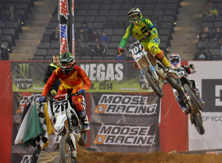 From left, #211 Brett McLaud of Cedar Rapids, IA, #101 Dylan Rouse of Verona, KY, and #29 James Beach of Manassas, VA, compete in the Pro Sport, the third race in Sunday's Baltimore Amateur AMSOIL Arenacross event at the Baltimore Arena. (Amy Davis/Baltimore Sun)