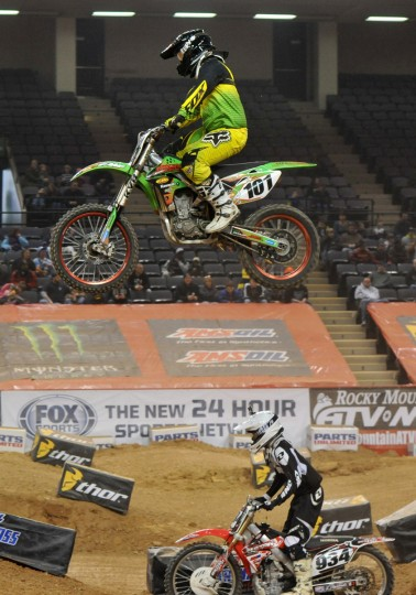 Dylan Rouse of Verona, KY, sails above #934 Alex Roe of Cordova, MD, in a qualifying race during the Baltimore Amateur AMSOIL Arenacross event at the Baltimore Arena. (Amy Davis/Baltimore Sun)