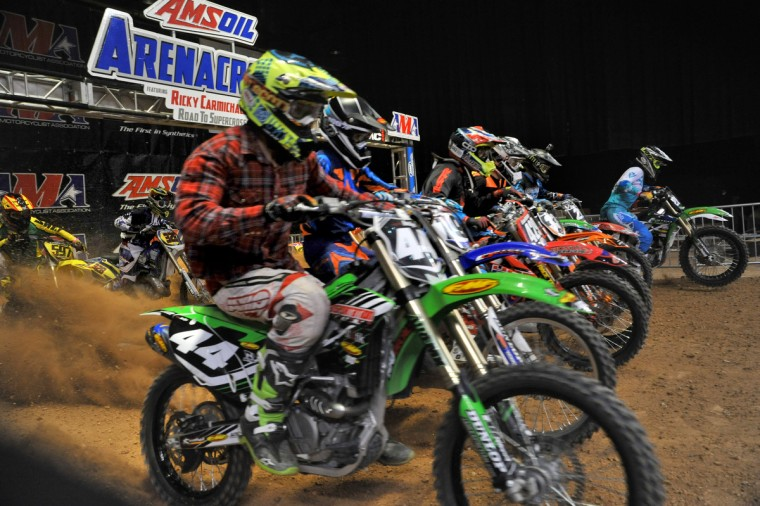 Jonah Locks of Dixon, CA, in front, charges out of the starting gate with the rest of the field in the AX Lites Intermediate race in the Baltimore Amateur AMSOIL Arenacross event at the Baltimore Arena. (Amy Davis/Baltimore Sun)