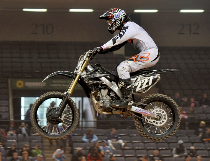 Mark Siegel of Nutley, NJ, is airborne during a qualifying race in the Baltimore Amateur AMSOIL Arenacross event at the Baltimore Arena. (Amy Davis/Baltimore Sun)