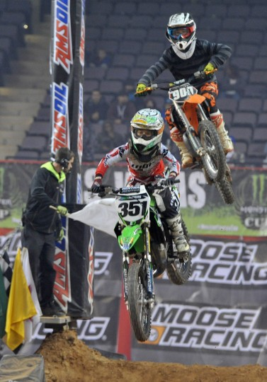 Jack Rogers of Brookeville, MD, and behind him, #900 Caden Florence of Parkersburg, WV, both clear the hill during the Supermini 1 race of the Baltimore Amateur AMSOIL Arenacross event at the Baltimore Arena. (Amy Davis/Baltimore Sun)