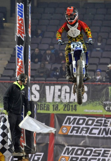 Nathan Murphy of Mount Airy, MD eyes the track as he crests the top hill in the Supermini 1 race during the Baltimore Amateur AMSOIL Arenacross event at the Baltimore Arena. (Amy Davis/Baltimore Sun)