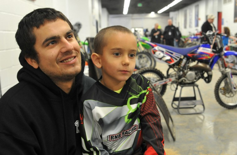 Steven Davis of Silver Spring and his son Parker, 6 1/2, were both racing in different events in the Baltimore Amateur AMSOIL Arenacross event at the Baltimore Arena. (Amy Davis/Baltimore Sun)