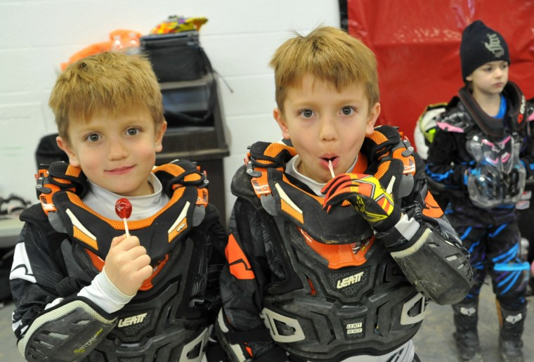 Twins Dominic, left, and Colton Stallings, 6, of Huntingtown, MD, take a lollipop break between races in the Baltimore Amateur AMSOIL Arenacross event at the Baltimore Arena. (Amy Davis/Baltimore Sun)