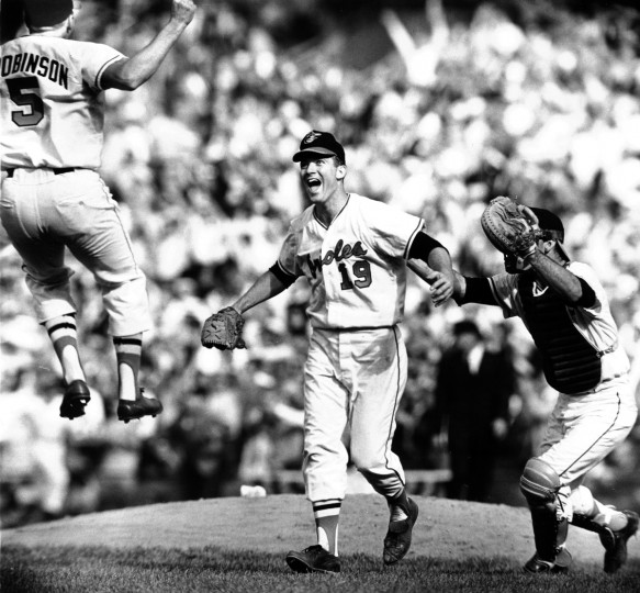 On October 10, 1966 third baseman Brooks Robinson and catcher Andy Etchebarren converge on pitcher Dave McNally after the Orioles swept the Los Angeles Dodgers to win their first World Series. (Paul M. Hutchins/Baltimore Sun)