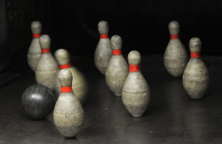 Duckpin bowling uses balls that are smaller and pins that are shorter than the size used in traditional 10-pin bowling. Patterson Bowling Center, the home of duckpin bowling, has been in existence since 1927. (Algerina Perna/Baltimore Sun)