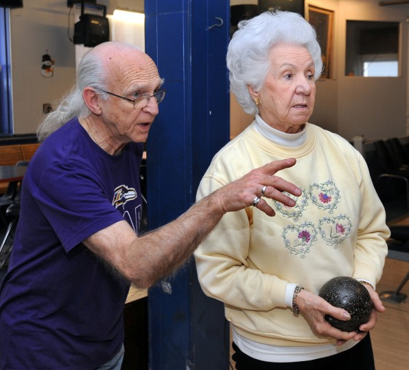 Richard Kulacki, 73, and Dorothy Meier, 88, who play in the John Booth Senior League, size up a shot at the Patterson Bowling Center. (Algerina Perna/Baltimore Sun)