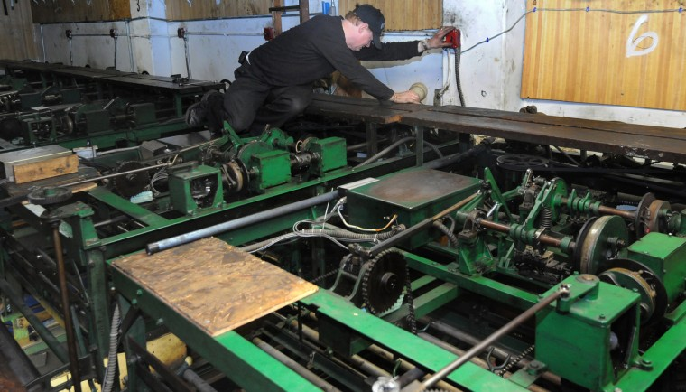 Charles McElhose Sr. says keeping the 1955 duckpin bowling machines up and running takes about 40 hours per week of mechanical labor. (Algerina Perna/Baltimore Sun)