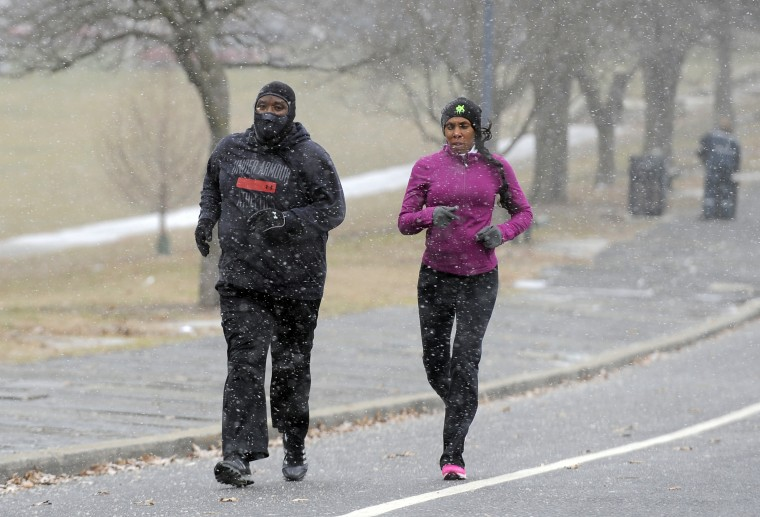K.C. Carter and Kecia Hamilton out for a run in Druid Hill Park during the morning snow. (Lloyd Fox/Baltimore Sun)