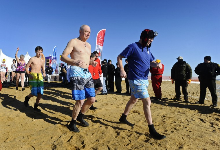 "The 18th annual MSP Polar Bear Plunge at Sandy Point State Park to benefit the Special Olympics Maryland. On Friday 41 ""Super Plungers"" plunge into the ice cold Cheaspeake Bay every hour for 24 hours. (Kenneth K. Lam/Baltimore Sun)"