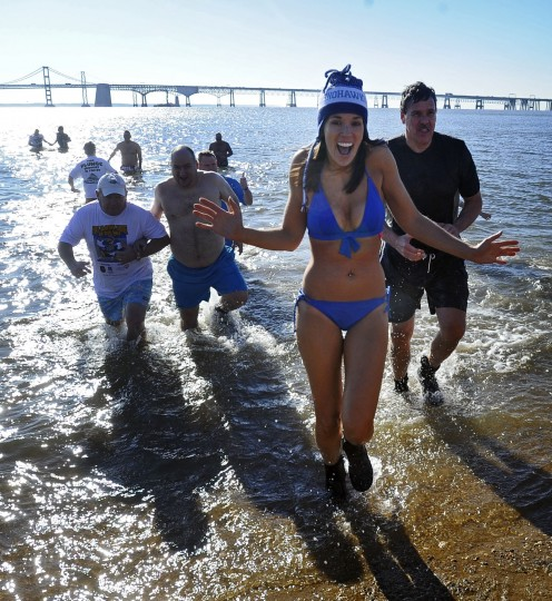 "The 18th annual MSP Polar Bear Plunge at Sandy Point State Park to benefit the Special Olympics Maryland. On Friday ""Super Plungers"" including Mary Kokosko, center, of Annapolis, go into the ice cold Cheaspeake Bay water every hour for 24 hours. (Kenneth K. Lam/Baltimore Sun)"