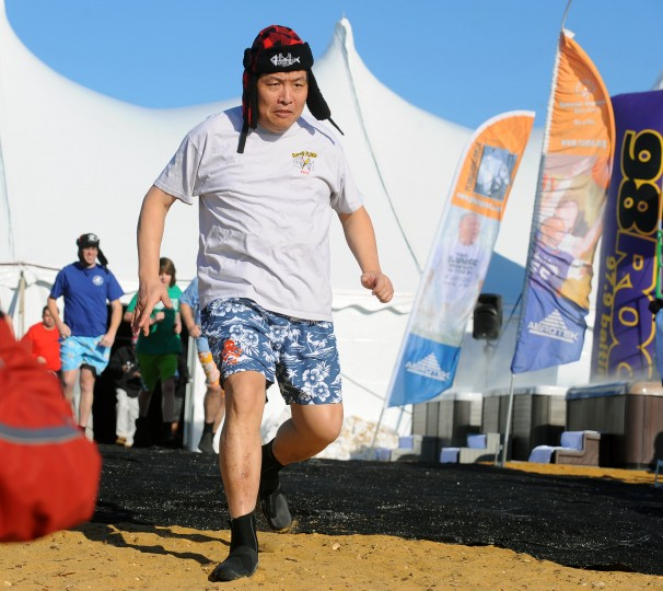 "The 18th annual MSP Polar Bear Plunge at Sandy Point State Park to benefit the Special Olympics Maryland. On Friday, 41 ""Super Plungers"" including Special Olympian Joe Wu, of Rockville, plunge into the ice cold Cheaspeake Bay water every hour for 24 hours. (Kenneth K. Lam/Baltimore Sun)"