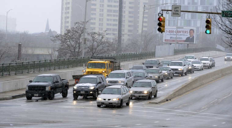 This is a view of cars along North Avenue as a snow storm starts in the city. (Barbara Haddock Taylor/Baltimore Sun)