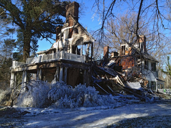 The remains of a mansion a day following a 3-alarm fire that gutted the late-18th century home on St. Georges Road in the North Roland Park area. (Karl Merton Ferron/Baltimore Sun)