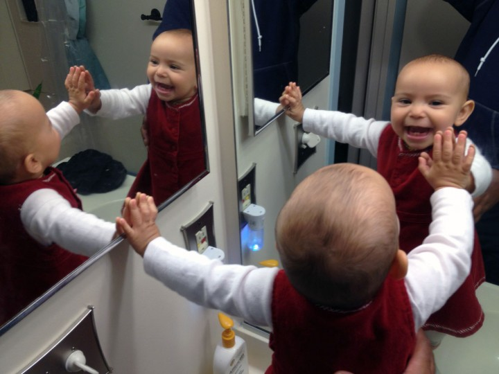 Standing on the bathroom counter, Karah Ferron smiles while looking into two mirrors on Oct. 12, 2013. (Karl Merton Ferron/Baltimore Sun Staff)