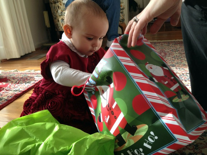 Karah Ferron opens a present at her grandparents' Elkridge home on Dec. 25, 2013. (Karl Merton Ferron/Baltimore Sun Staff)