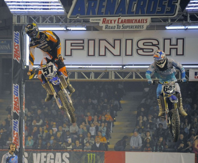 Aaron Plessinger (57) and Keith Tucker race in Heat 2 of the AMSOIL Arenacross Lites East race at Baltimore Arena, Jan. 11, 2014. (Karl Merton Ferron/Baltimore Sun Photo)