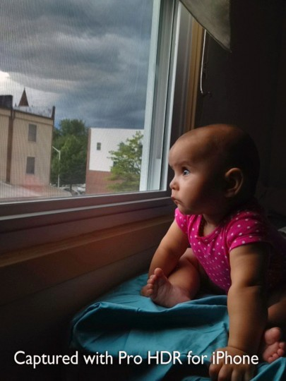 Karah Ferron looks with wonder as a strong storm approaches the area on July 7, 2013. (Karl Merton Ferron/Baltimore Sun Staff)