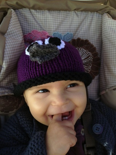 Karah Ferron wears a purple knitted bird cap while sitting in her car seat on Nov. 3, 2013. (Karl Merton Ferron/Baltimore Sun Staff)