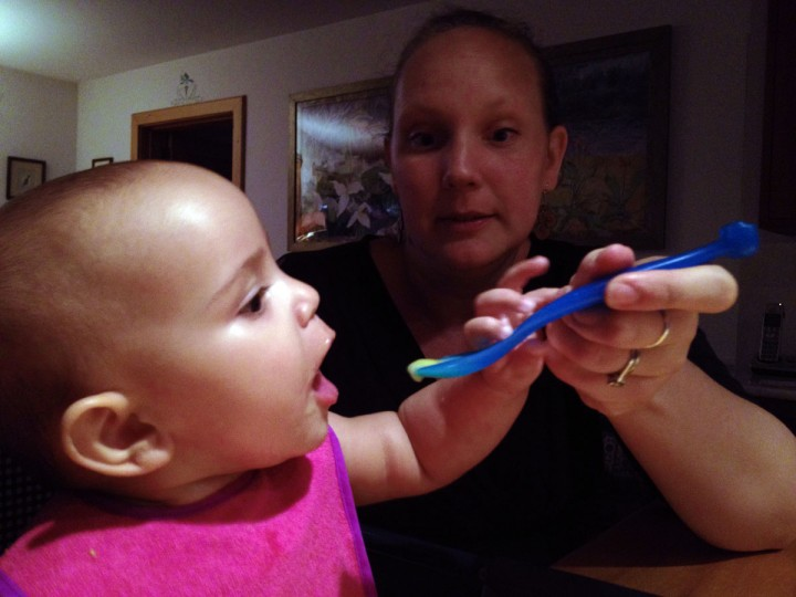 Karah Ferron eats baby food for the first time with the help of her mother on July 23, 2013. (Karl Merton Ferron/Baltimore Sun Staff)