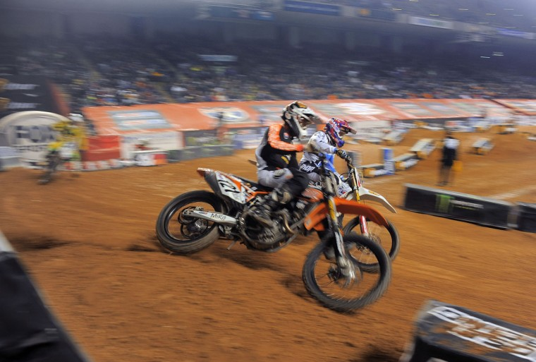 Lane Staley (in the foreground) and Michael Lang compete in Heat 2 of the AMSOIL Arenacross Lites East race at Baltimore Arena, Jan. 11, 2014. (Karl Merton Ferron/Baltimore Sun Photo)