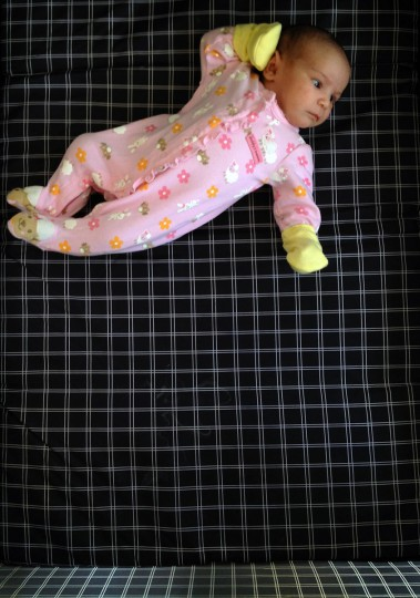 Karah Ferron seems as though she is jumping but is actually lying in a portable crib on Feb 6, 2013. (Karl Merton Ferron/Baltimore Sun Staff)