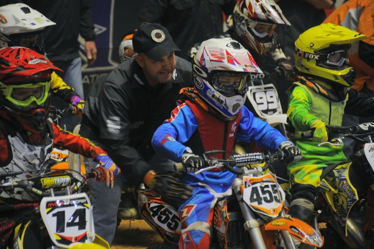 Anthony Brion talks to his eight-year-old son Xander before the start of an Arenacross race at the Baltimore Arena, Jan. 11, 2014. Xander wound up winning. (Karl Merton Ferron/Baltimore Sun Photo)