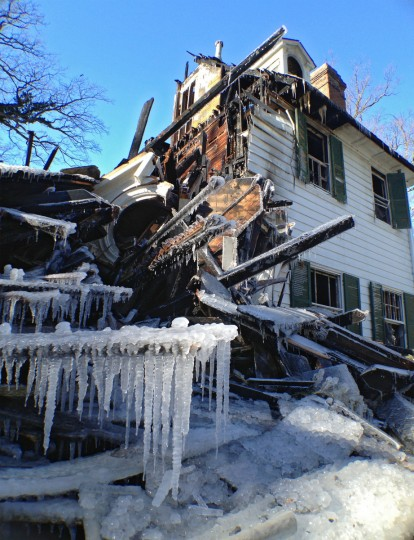 Icicles dangle on a wood beam among the rubble of the remains of the mansion. (Karl Merton Ferron/Baltimore)